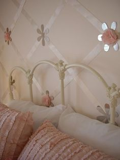 easy way to decorate a girls room:criss crossed satin ribbon, then add  mirror flowers ..