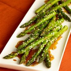 This vegetable side dish is as easy as it is delicious. Roasting the asparagus results in tender, yet crisp stalks, and the dressing adds sweet, nutty flavor.