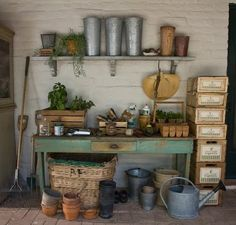 . The homeowner had a covered walkway along a wall that filled the bill for potting space. They simply added a rustic table and shelves to house their gardening gear.
