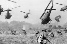 U.S. Army helicopters pour machine gun fire into tree line to cover the advance of South Vietnamese ground troops in an attack on a Viet Cong camp near the Cambodian border, in March 1965 during the Vietnam War. (Credit: AP/Horst Faas)