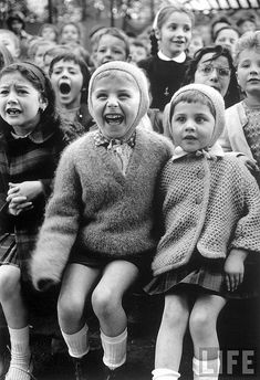 Alfred Eisenstaedt, Paris, 1963    Children with various range of expressions watching story of St. George and the dragon at the puppet theater in the Tuileries. LIFE Magazine.