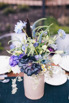 Purple Vintage Centerpiece | Photo: Monika Greenaway Photography, Floral Designer: Lilify