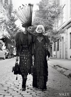 On Hammam, far left: Louis Vuitton mink and feather trimmed jacket, embroidered blouse, skirt with Stephen Sprouse graffiti embroidery, feather headdress, bag, and boots; select Louis Vuitton boutiques. On Sam Rollinson: Marc Jacobs taffeta Victorian dress and shoes; Marc Jacobs, NYC.