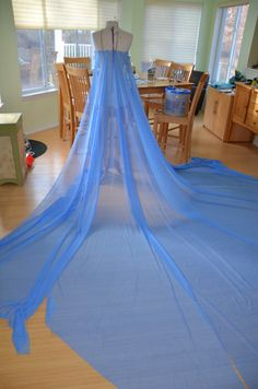 How to make elsa's cape. How she made her's is pretty smart. Got to think about this for drape.