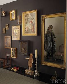 In the entry hall, artworks include Russian icons and a 17th-century Italian painting; the small chair is by BDDW, an