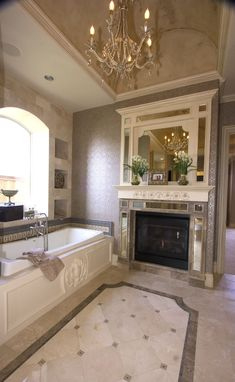Master bath with marble floors, tub surround & fireplace surround, built in whirlpool tub, barrel vault ceiling and more.