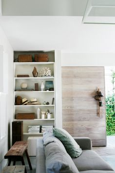 Love the whitewashed timber feature wall, the rumpled cosiness of the couch, and the built in shelving with nic-nacs from island travels. www.homelife.com.au