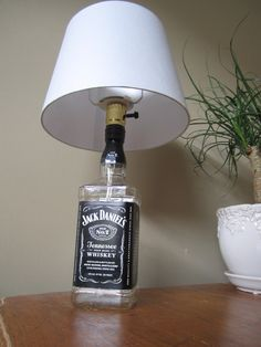 Liquor bottle made into a lamp.Great for home decor, bars, and man caves. Fully functional with shade included. All you have to do is put a light bulb in it, and your ready to go.Thanks for looking at our site!  http://www.etsy.com/listing/97371149/jack-daniels-liquor-lamp?ref=sr_gallery_26_includes%5B%5D=tags_search_query=Liquor_search_type=all_view_type=gallery#