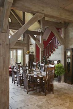 The dining table was made by Mennonite craftsmen, who used quarter-sawn oak. The Mission-style high-back chairs to match the timber-frame portion of the home.