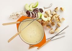 Fondue is the classic crowd-pleasing party appetizer. Make sure to mix up a couple of cheeses for the best results.