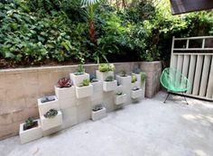 Cinder block garden. I need to block the bottom somehow!
