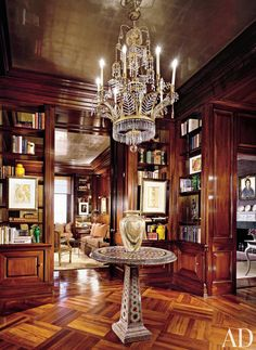 The entrance gallery of a Manhattan apartment also serves as a library.