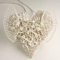 """clockwork love"", paper cut art"
