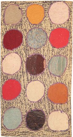 Antique American hand hooked rug, circa 1930. Irregular circles in green, blue, maroon, red, and burnt orange hover balloon-like against an abrashed sage green ground.