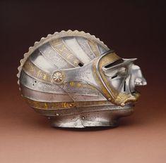 Close helmet with mask visor, ca. 1515  Attributed to Kolman Helmschmid (German, 1471–1532)  Augsburg, Germany  Steel, embossed, etched, and gilt