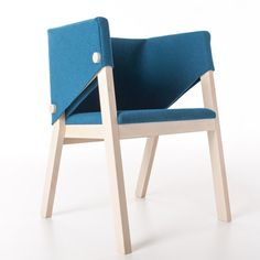 A single piece of felt wraps around the back and armrests of this solid wooden rocking chair
