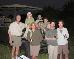 """Christine Juneau's Family (Staff Artist): """"This was taken during 'sundowners' on our first day at Duba Plains in the Okavango Delta shortly after spotting what would be unanimously voted our all-time favorite animal—the almighty warthog."""""""