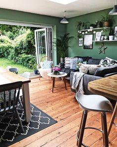 Green walls interlink with the outdoor space and plenty of plants bring it all together in this open plan kitchen diner. #melaniejadedesigns #greenery #green #kitchen #kitchendiner #ikea
