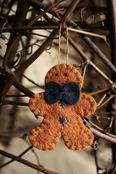 little gingerbread man felt ornament / brooch by urbanpaisley, $10.00