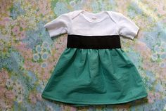 Super easy, Super cute! Onsie upcycled into a little dress using wide width elastic.