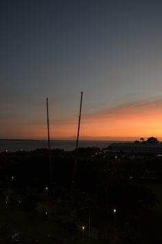 The view from an upper balcony of Cairns Pacific Hotel of a glorious sunrise over cairns harbour.www.pacifichotelcairns.com for Cairns accommodation. #cairns #cairnsaccommodation #thisismyparadise