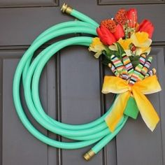 Welcome spring with this simple and unique Garden Hose Spring Wreath!