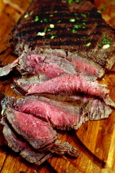Asian Marinated Grilled Flank Steak. Plus, how to make a flank steak as tender as filet mignon.