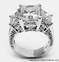 Princess Cut Diamond Engagement Rings    18KT WHITE GOLD THREE STONE PRINCESS CUT DIAMOND RING    CENTER STONE EGL CERTIFIED 5.00CT PRINCESS CUT DIAMOND    SIDE STONES 4.20CT TW PRINCESS CUT DIAMONDS   (regalcollectioncorp.com)  Details    cut: Princess   gem: Diamond   Jewelry Type: engagement rings   metal: White gold   Wedding Style: classic