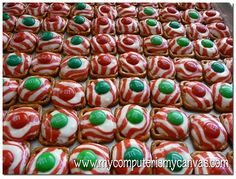 square pretzles and peppermint heresy kisses found at target right now, with red and green m & m's, did something similar to this for halloween with recesses and chocolate heresy kisses...however this sounds fun for xmas! heat at 275 for   2-3mins in oven then press m & M into kiss wala!