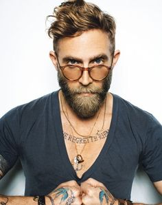 RB: tats, glass, hair style and perfect beard