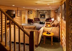 Pine logs were cut in half and affixed to the walls, giving the room its rustic cabin look. Copper Rust stacked stone and a slate floor prov...