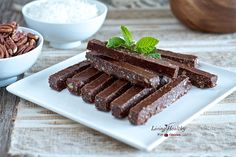 Peppermint Chocolate Sticks - made with coconut oil, cocoa powder, almond butter, raw honey, vanilla extract, peppermint extract, salt, shredded coconut, and pecans.
