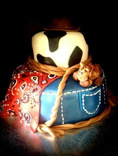cowboy baby shower cake - MM Fondant, hat is gumpaste, horse is fondant with tootsie roll hair and hooves, bandana is piped with buttercream.