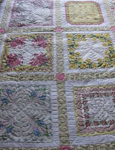 Jeanette's Handkerchief quilt    Vintage hankies were appliqued onto a white cotton. Sashing and a border completed this delightful quilt. Special custom feather quilting was added to enhance the feminine quilt.