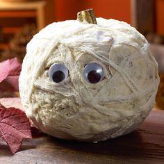 Create an easy DIY Glow-in-the-Dark Mummy Pumpkin for Halloween decor