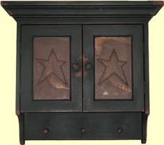"This Star Cupboard captures the true look and feel of Colonial America, recreating 17th, 18th, and 19th century primitive American country furniture.  It is an authentic design, handmade, then painted with an authentic milk paint color, and finished with a timeworn and aged patina, giving it that original old look.  Measures 26"" High x 24"" Wide x 8"" Deep"