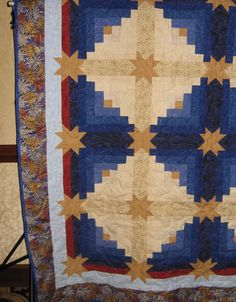 "Using Eleanor Burns' ""Star Log Cabin"" pattern, I made this king-size version for the San Diego Astronomy Association raffle several years ago."