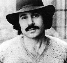 mustache? no paul simon