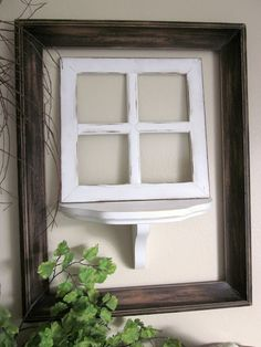 white frame made out of paint stir sticks....