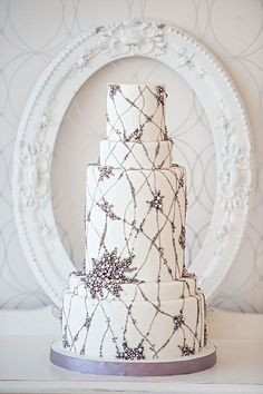 White Wedding Cake with Silvery Lilac Pearl Details