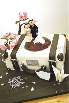 luggage to Japan wedding cake