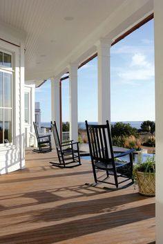 Huge porch with rocking chairs.