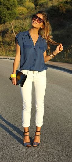 white skinny jeans, blue shirt / blouse, summer sandals & clutch.