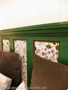 The headboard was an old door that Jessica had. We chopped off about a foot and 1/2 and added crown molding and painted it with Krylon Emerald Green. The panels inside are covered with Ikea fabric and I put nailhead trim along the insides.