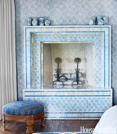 Blue tiled fireplace. Different... and not displeasing.