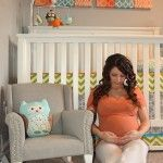gender neutral nursery in orange, gray & green