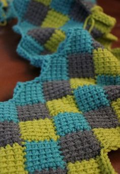 This is an entrelac pattern which is worked in Tunisian crochet.  Finished size will be a large throw.