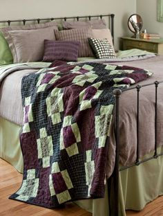 When temperatures drop, curl up in a bed-size flannel quilt with pops of green that hint at spring.