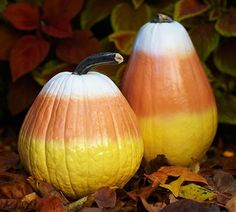 Spray paint pumpkins and gourds to look like candy corn