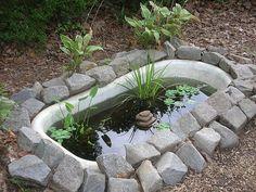 Claw foot bathtub garden pond